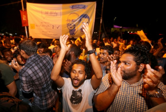 Supporters of Maldivian joint-opposition presidential candidate Mohamed Solih celebrate in Maldives