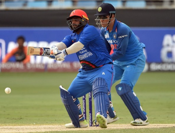 Mohammad Shahzad and MS Dhoni