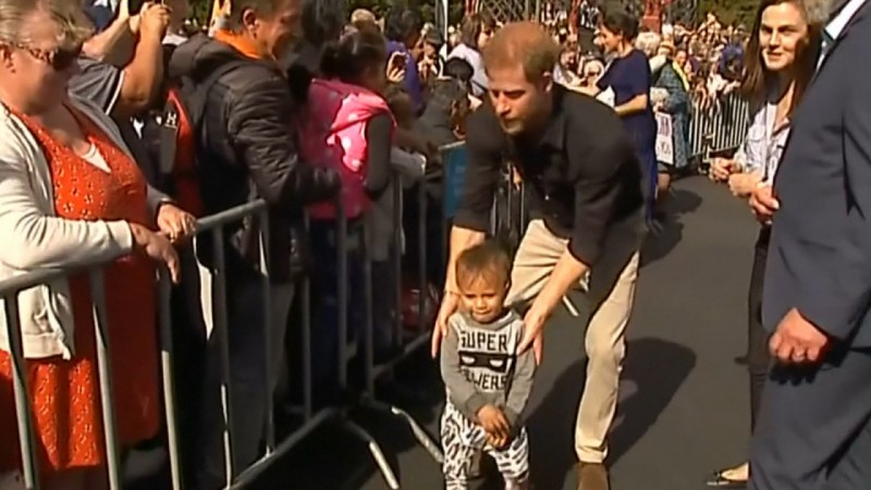 Whose Child Is This? Prince Harry And Meghan Markle Meet Crowds