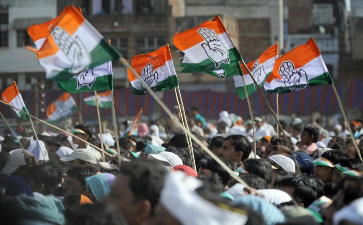 Supporters wave Congress Party flags