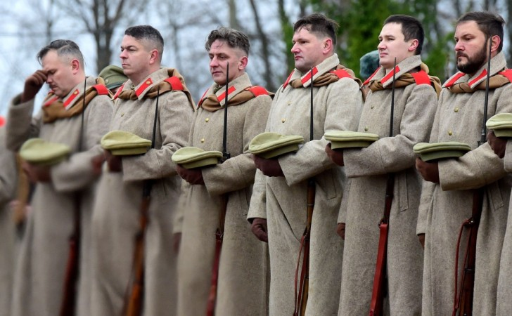 Members of military history clubs wearing WWI Russian military uniforms attend a ceremony marking the centenary of the Armistice Day at the Brotherly cemetery of WWI heroes in Tsarskoye Selo outside Saint Petersburg on November, 11, 2018.