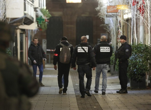 Police investigate near the scene of a shooting in the center of Strasbourg, France, on Dec. 11, 2018.