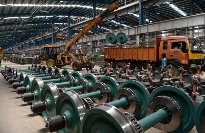 Indian labourers work to build an Indian Railways locomotive coach at Integral Coach Factory in Chennai