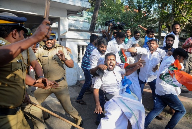 Indian police beat Congress Party supporters as they take them into custody during a protest march