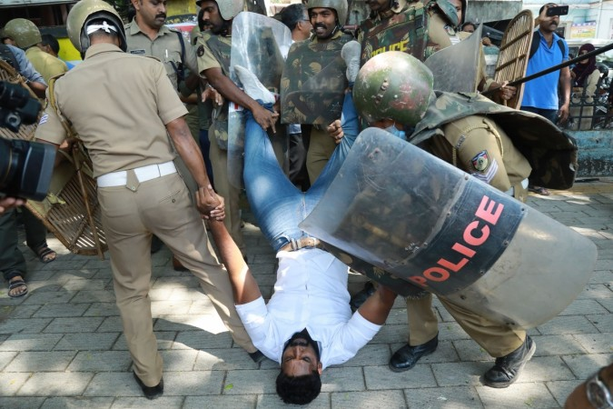Police detain an Indian activist amid demonstrations after women entered the Sabarimala temple