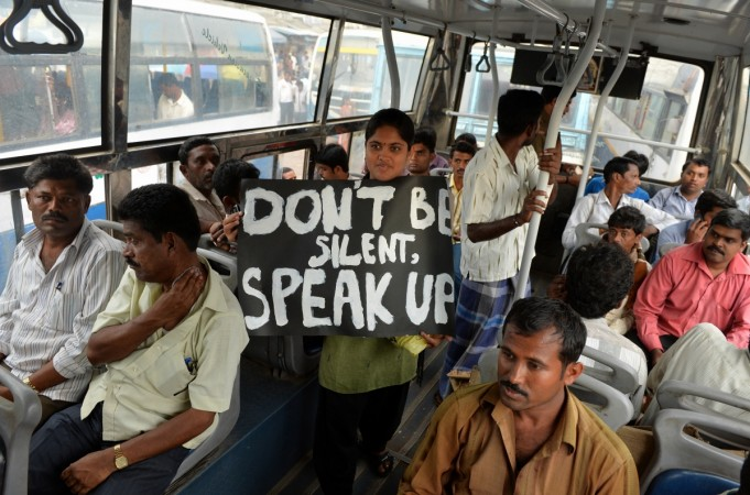 An Indian protester belonging to the Bangalore Bus Passengers Forum holds a placard, against the sexual harassment of women passengers