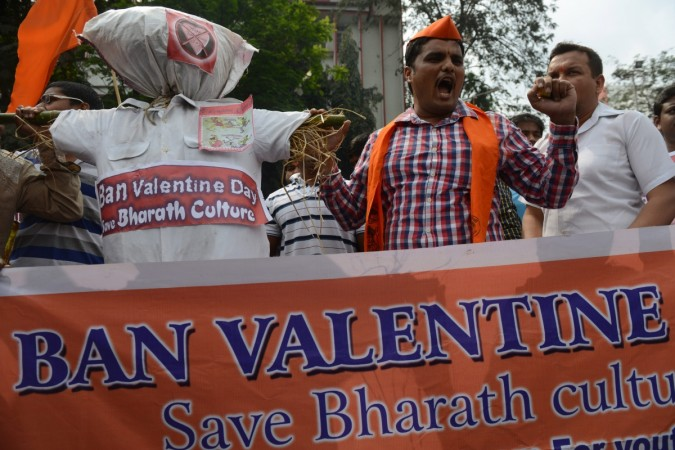 Indian activists of the youth-wing Hindu organisation the Bajrang Dal carry an effigy representing Valentine's Day as they shout slogans in Hyderabad on February 14, 2014.