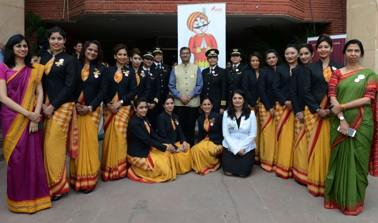 Chairman and Managing Director Air India, Ashwani Lohani (C) stands with the pilots and crew members of an all-women Air India