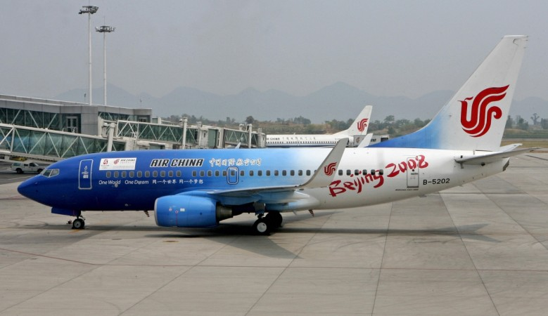 an Air China Boeing 737 jet painted to promote the Beijing 2008 Olympic Games, prepares to leave Chongqing airport