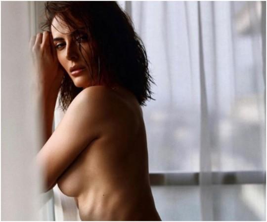 Mandana Karimi goes topless