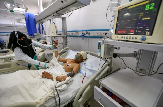 Yemeni boy lies in a hospital bed