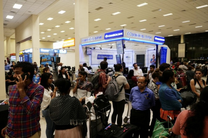Passengers queue up for taxi at the Bandaranaike International Airport in Colombo, Sri Lanka, April 22, 2019.