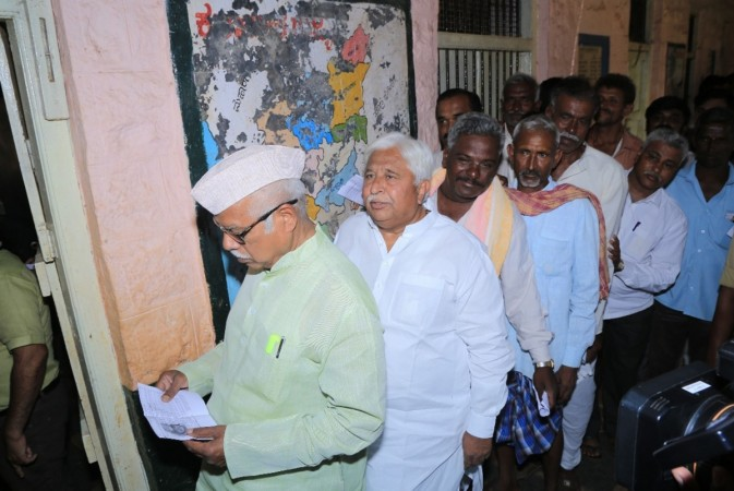 Congress leader H. K. Patil waits for his turn to cast his vote for the third phase of 2019 Lok Sabha elections, at a polling station in Karnataka's Gadag, on April 23, 2019