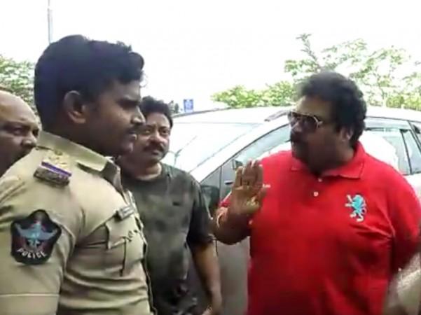 Ram Gopal Varma and producer Rakesh Reddy arguing with Vijayawada police
