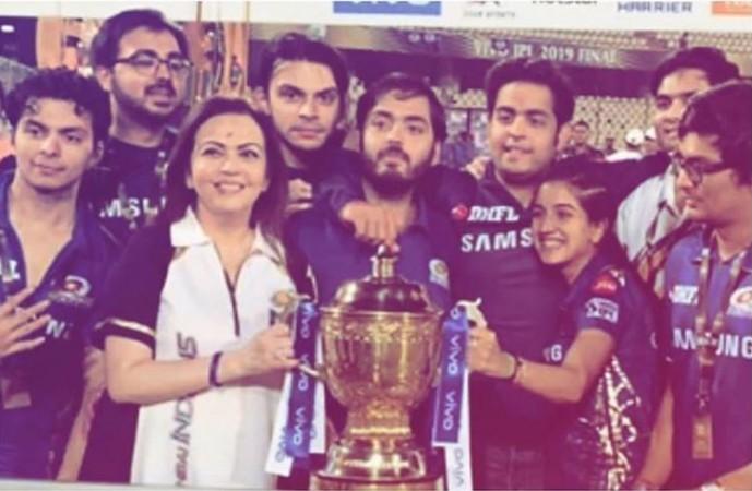 Mumbai Indians owner Ambani family with IPL 2019 trophy