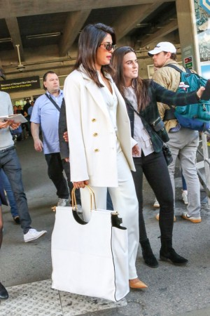 Priyanka Chopra in white suit, as she arrives at Cannes 2019