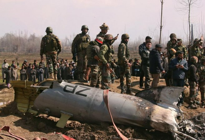 Indian soldiers stand next to the wreckage of an Indian Air Force helicopter after it crashed in Budgam district in Kashmir, February 27. REUTERS/Danish Ismail
