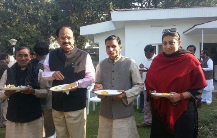 Surendra Singh with BJP leader Smriti Irani