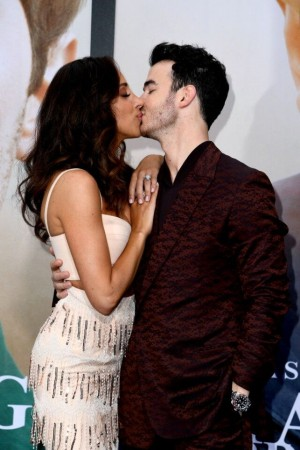 Danielle Jonas and Kevin Jonas kiss at Chasing Happiness premiere