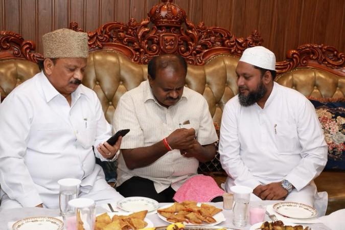 IMA director Mohammed Mansoor Khan with Shivajinagar MLA R Roshan Baig and Karnataka CM HD Kumaraswamy