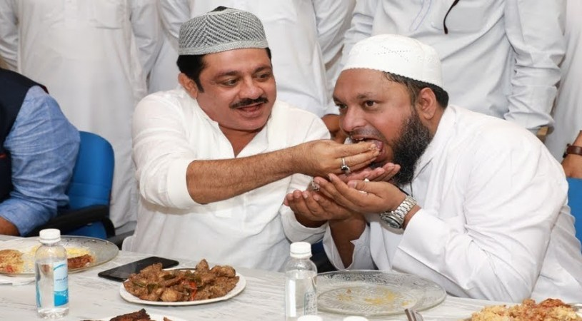 IMA director Mansoor Khan with Minister BZ Zameer Ahmed in an iftaar party.