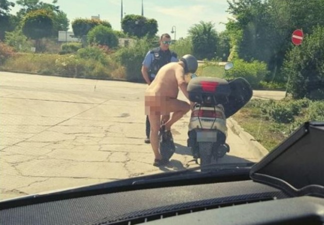 Nude scooter rider