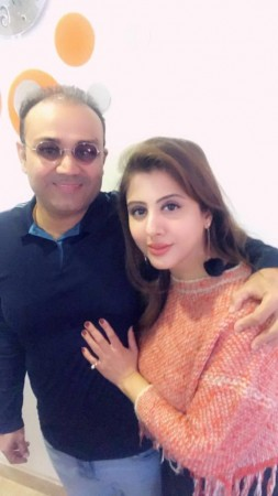 Virender Sehwag and his wife Aarti Sehwag.
