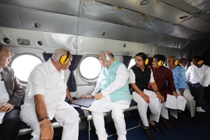 HM Amit Shah and Karnataka CM BS Yediyurappa doing an aerial survey of the flood affected areas of Belagavi district