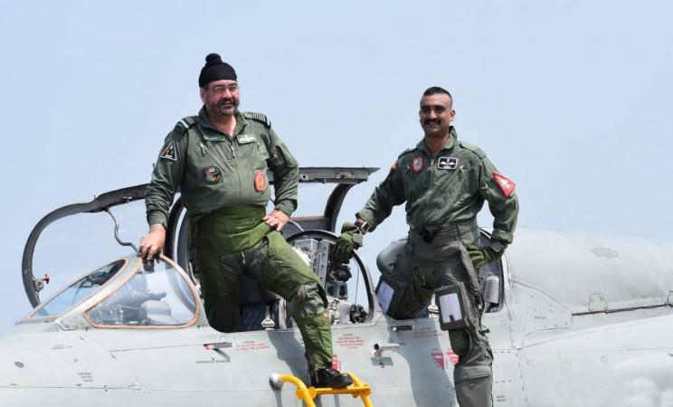 IAF chief BS Dhanoa with Wing Commander Abhinandan Varthaman on MiG-21