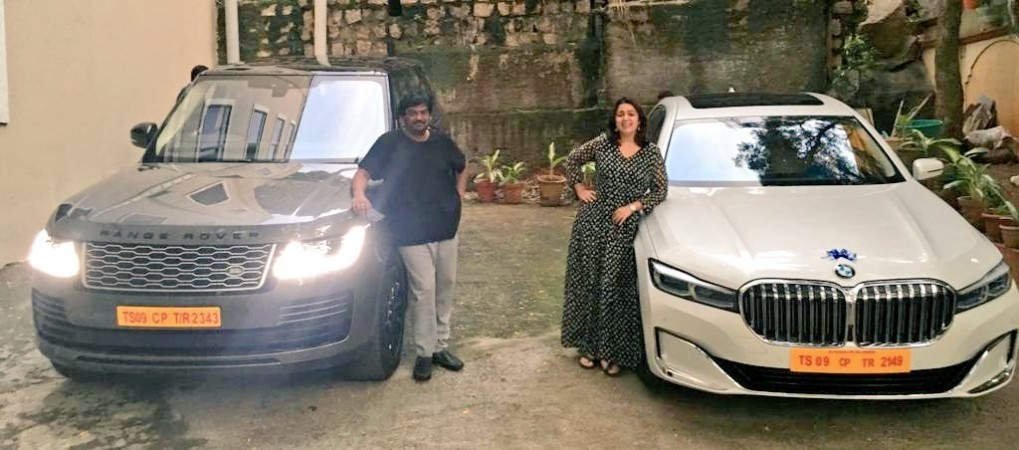 Puri Jagannadh and Charmy Kaur pose with their Range Rover Vogue and BMW 7 Series cars