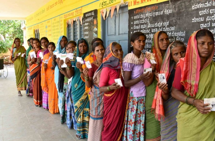 Raichur: Women voters wait in a queue to cast their votes for the third phase of 2019 Lok Sabha elections, at a polling station in Karnataka's Raichur, on April 23, 2019