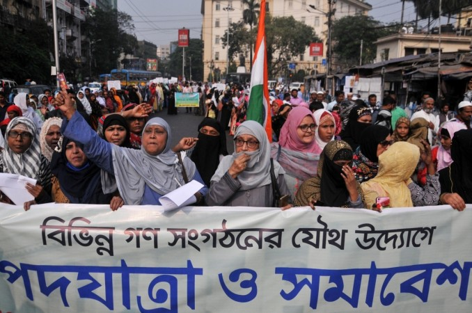 Members of Muslim community participate in a protest rally against CAB