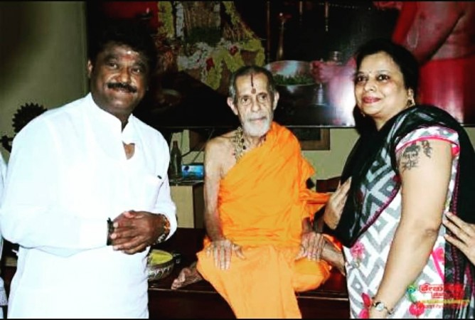 Kannada actor Jaggesh and his wife with Pejavara Mutt Seer Vishwesha Teertha Swami