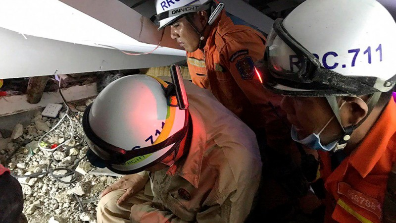 A rescue team searches for trapped workers at a collapsed building, which was under construction in Kep, Cambodia January 3, 2020.