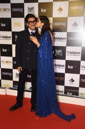 Deepika Padukone and Ranveer Singh kiss of love