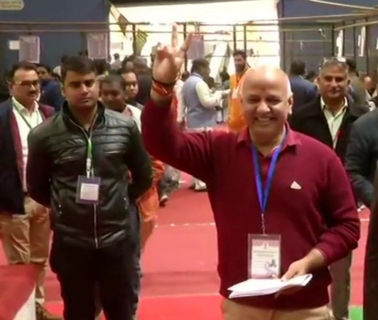 Manish Sisodia shows victory sign