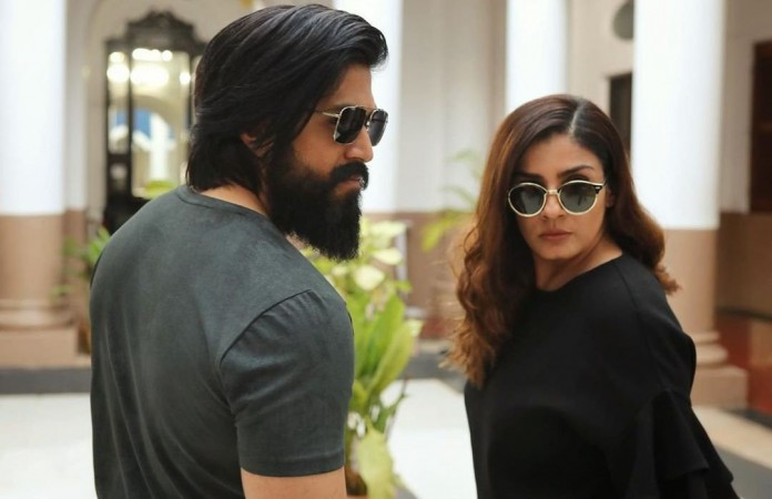 Yash with Raveena Tandon in KGF 2