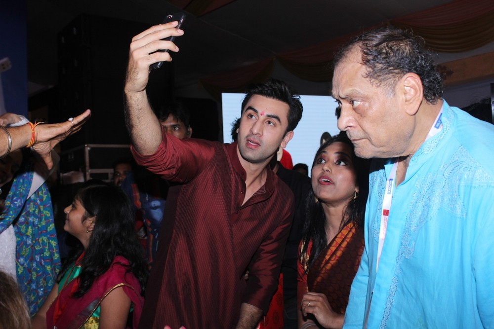 Bollywood celebs like Kajol and Ranbir Kapoor are celebrating Durga Ashtami with family and friends. The Tamasha actor greeted all his fans and was all smiles for the shutterbugs.