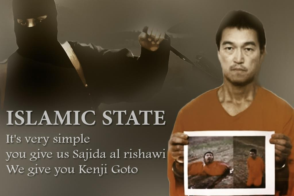 In the latest ISIS video,Japanese journalist Goto is seen holding what appears to be a Photoshopped image of the Jordanian pilot