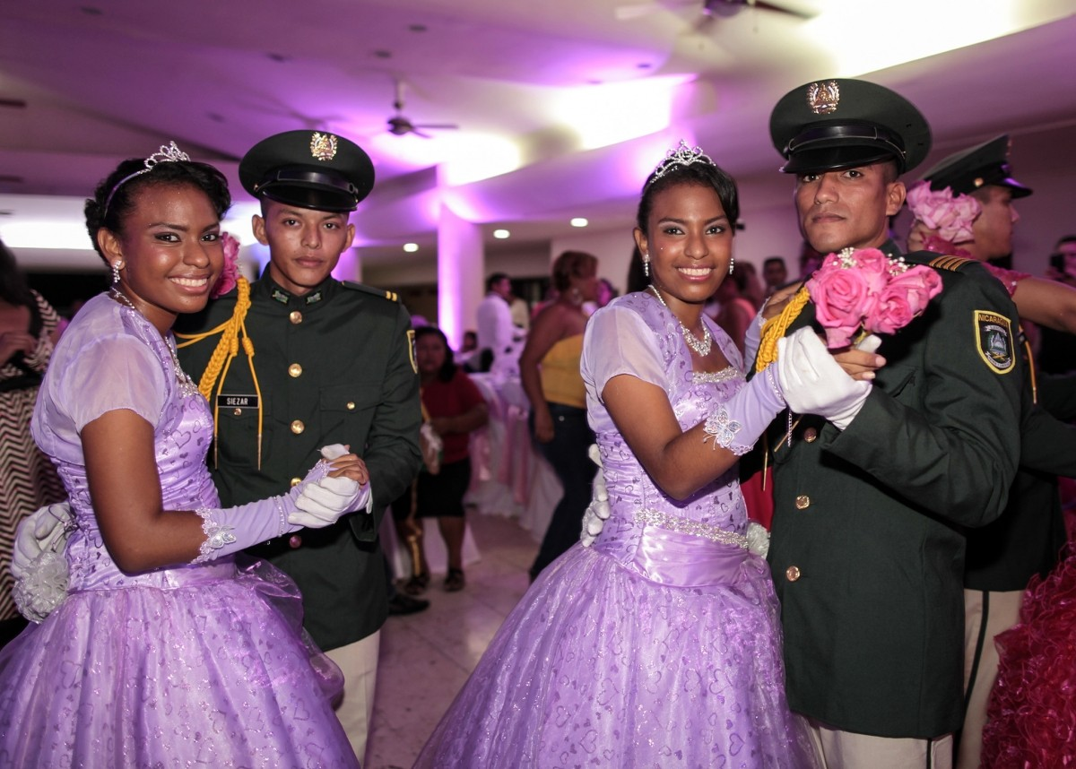 Twin cancer patients dance with cadets from Nicaragua's Military Academy during their