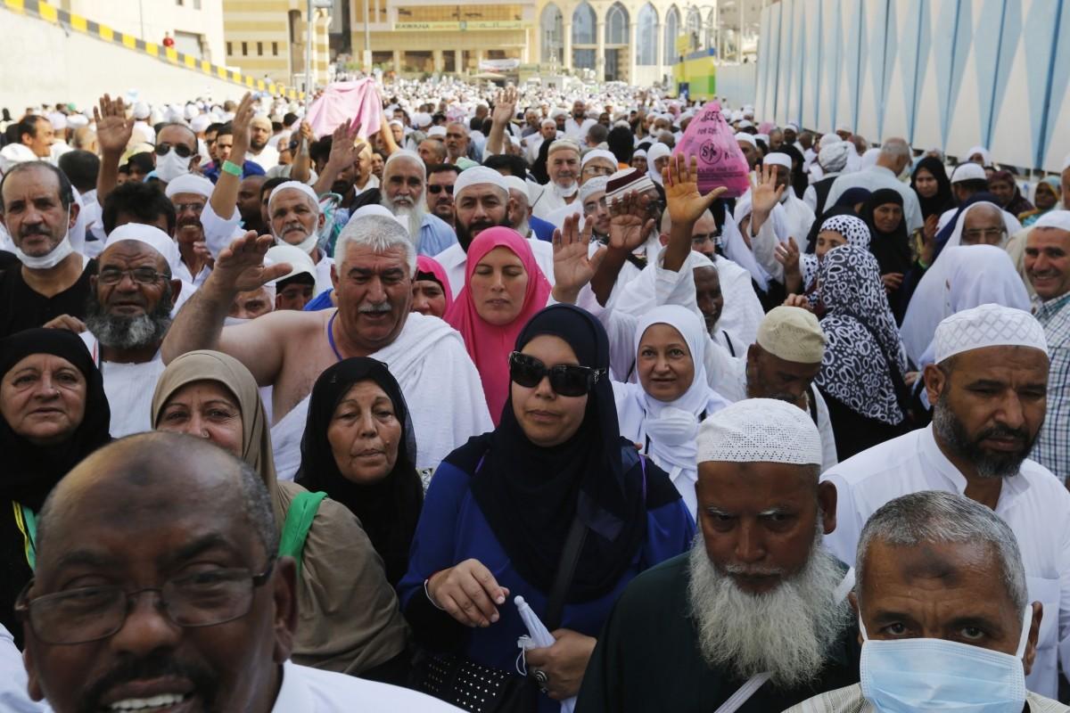 Muslim pilgrims walk towards the Grand Mosque during the annual Hajj pilgrimage in Mecca