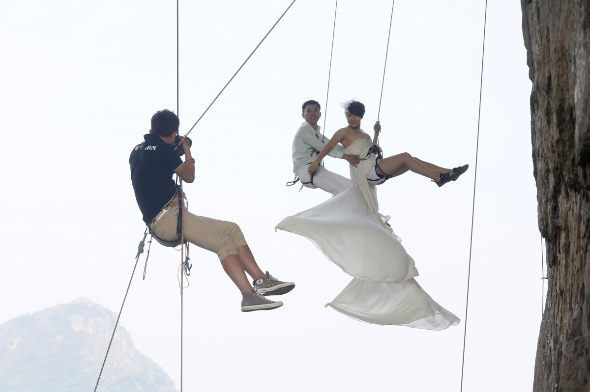 Wedding photos taken during rock climbing