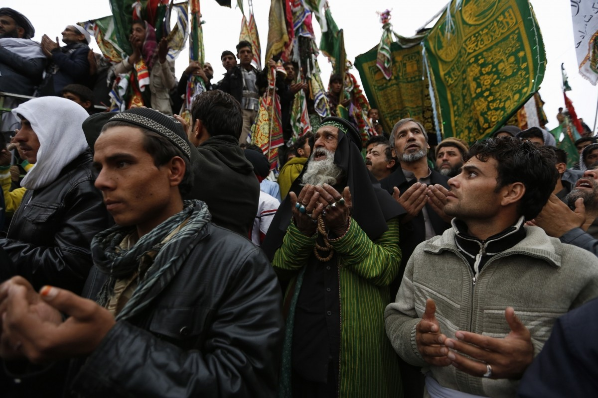 Afghans pray during a procession held to mark Ashura in Kabul