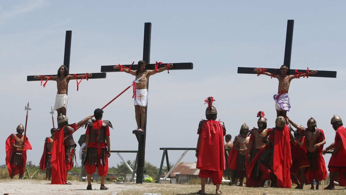 Penitents hang on wooden crosses during the re-enactment of the crucifixion of Jesus Christ on Good Friday in San Fernando, Pampanga in northern Philippines April 18, 2014. Nearly 20 Filipinos and a Danish filmmaker were nailed to crosses to re-enact the