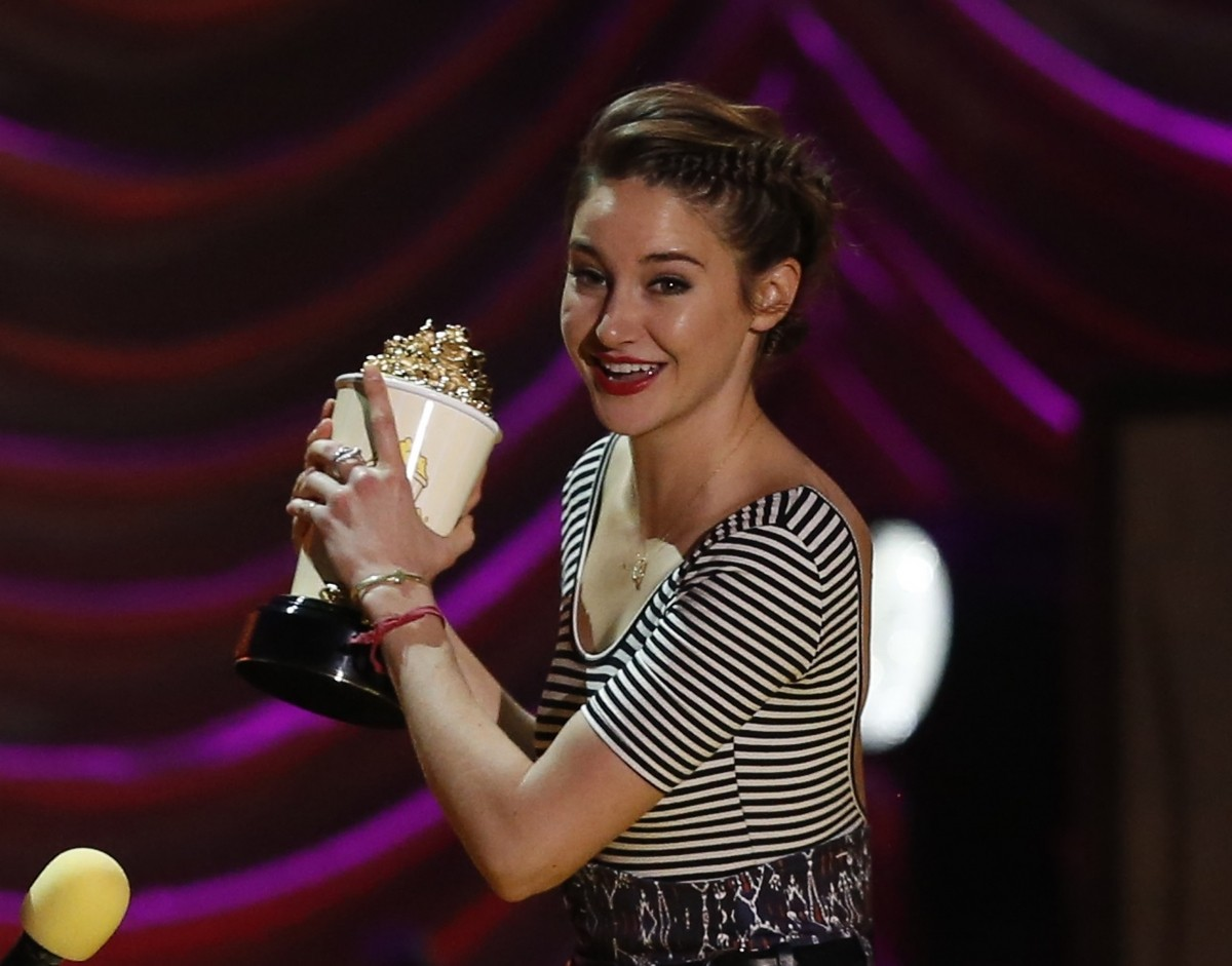 Actress Shailene Woodley accepts the award for Best Kiss for