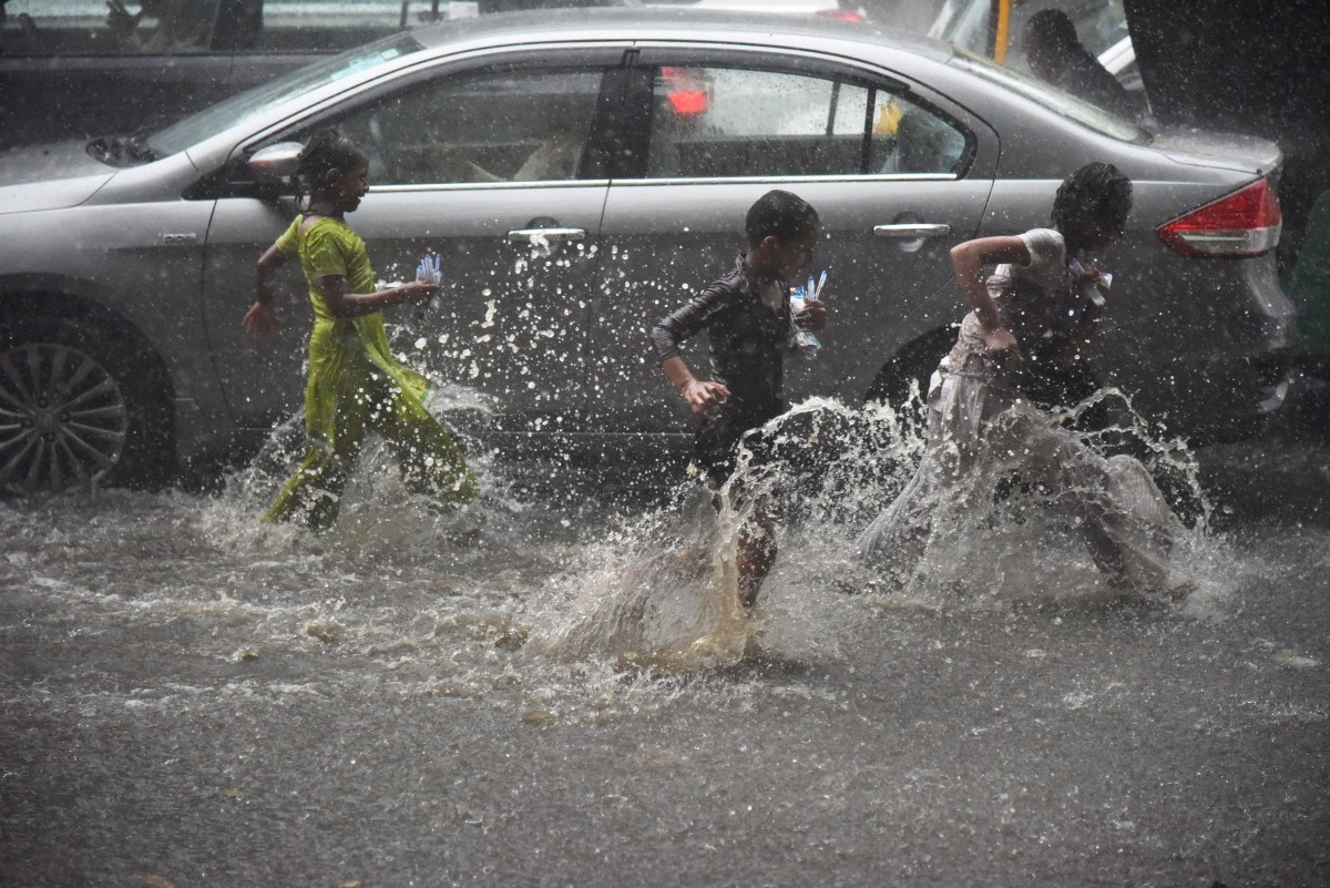 Kids playing in Delhi rains