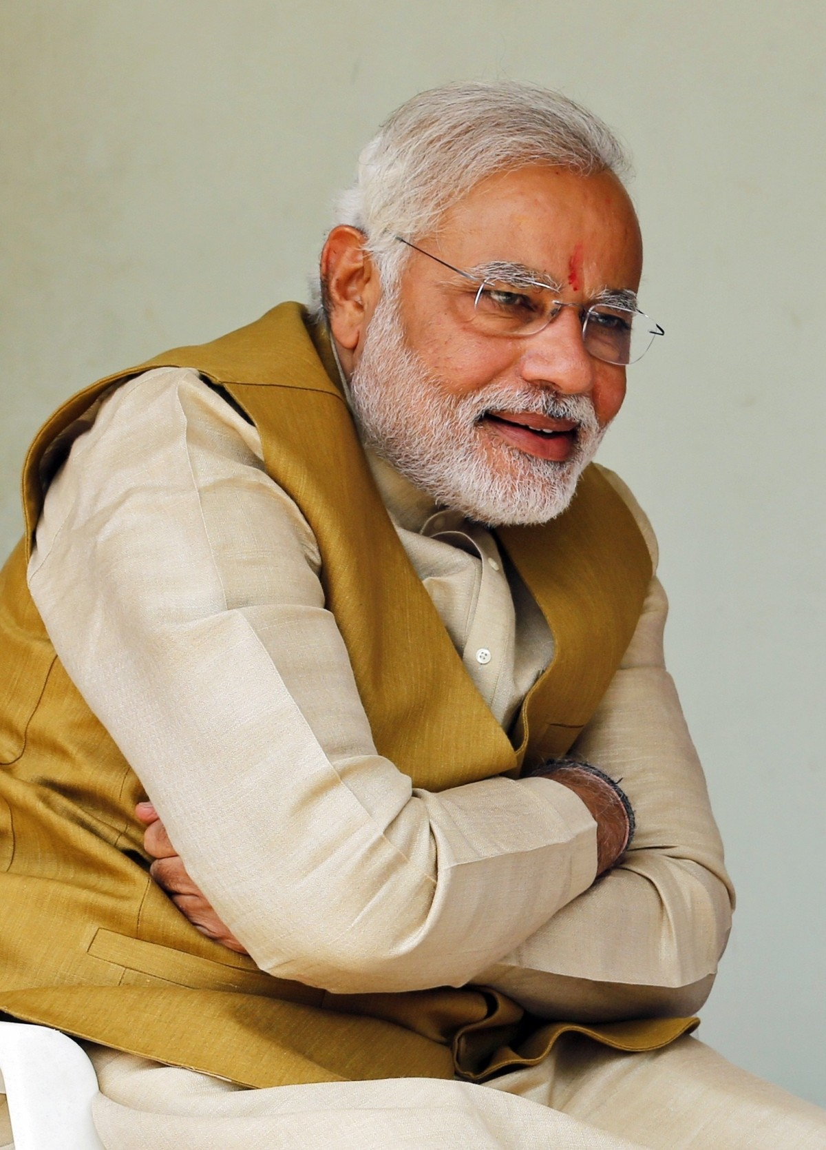 Hindu nationalist Modi, prime ministerial candidate for India's main opposition BJP, smiles as he speaks with his mother Heeraben after seeking blessings from her at her residence in Gandhinagar