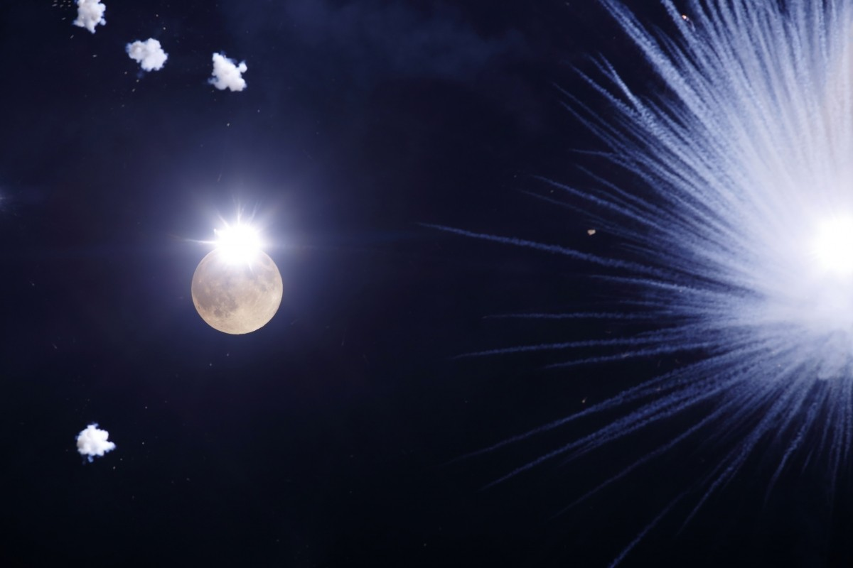 Fireworks explode in front of the supermoon outside the town of Mosta, celebrating the feast of its patron saint, in central Malta, August 10, 2014.
