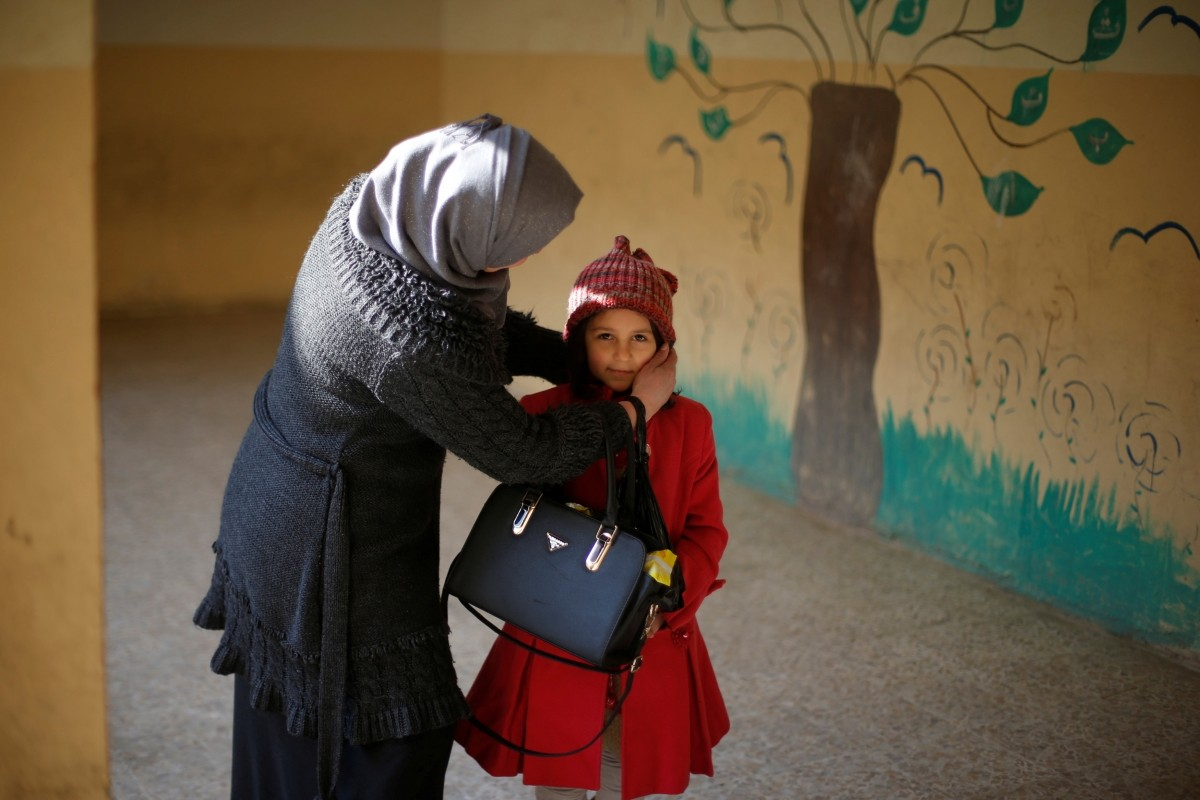 An ISIS-scarred child gets ready to return to school in east Mosul, Iraq