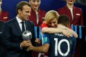 Croatian president's hugs, Putin's umbrella and Macron's Pogba dab: Leaders steal the show after World Cup final